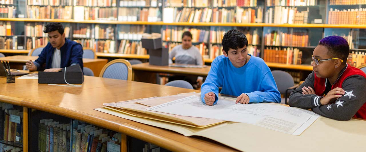 Students studying with rare books and archives